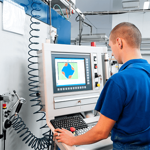 worker-operating-cnc-machine-center-18211368.jpg
