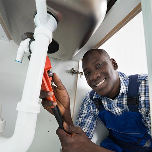 handyman-repairing-sink-pipe-56844343.jpg